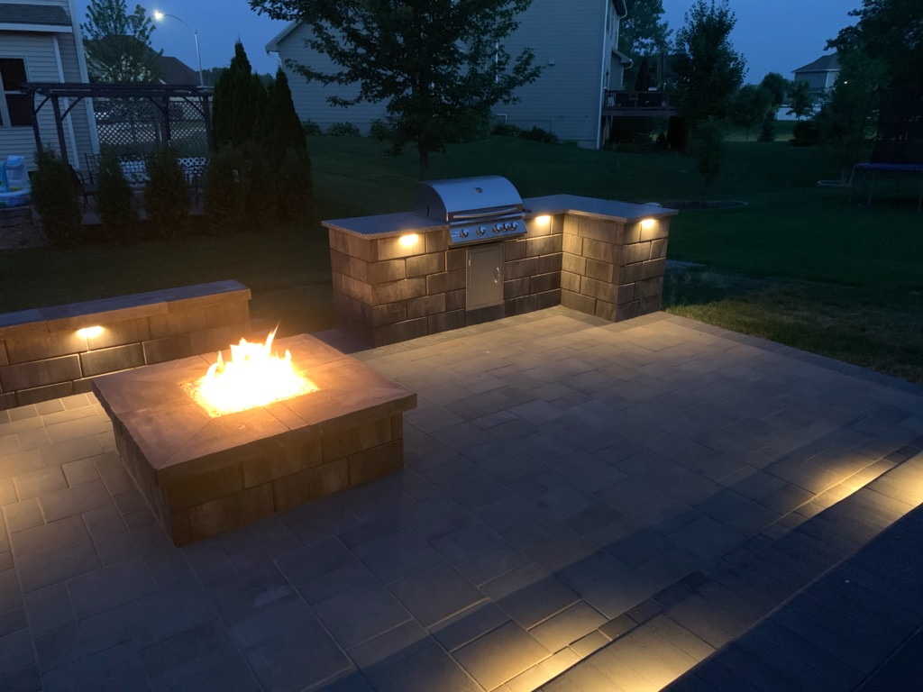 Outdoor lighting highlighted by a firepit