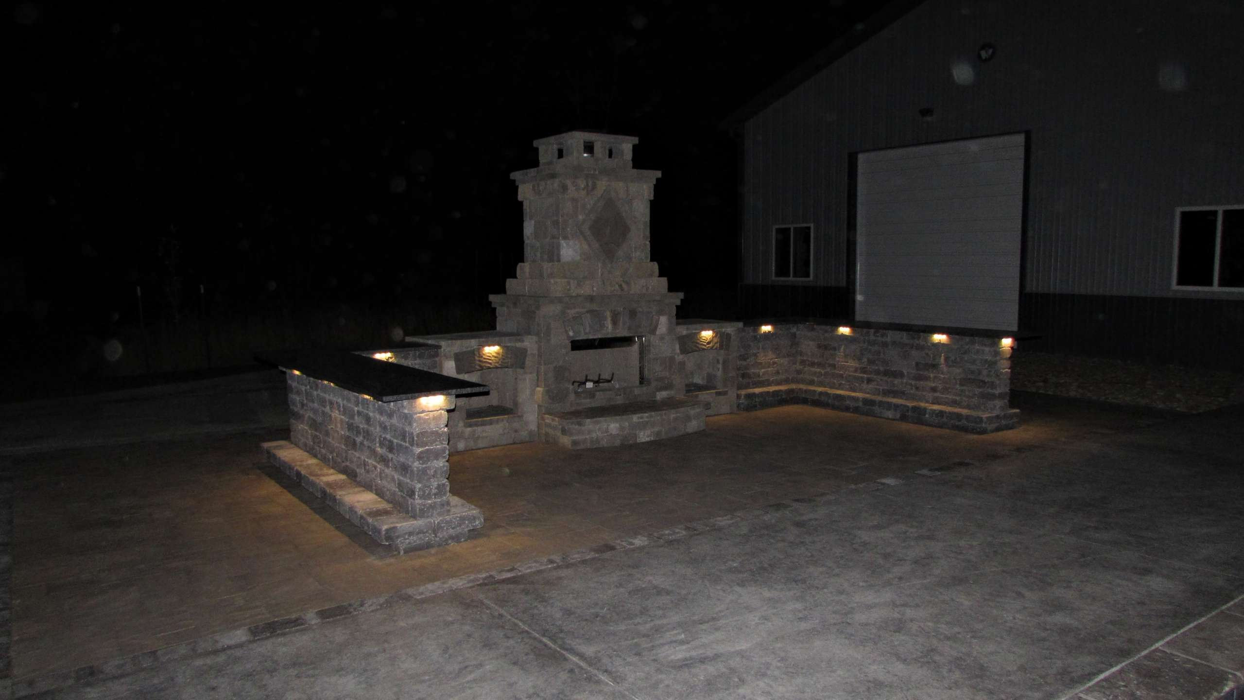 Stone feature being highlighted at night using well placed light structures